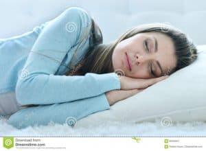 woman-sleeping-pillow-portrait-beautiful-young-95556541